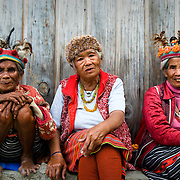 PHILIPPINES (Banaue, Province of Ifugao). 2009. Ifugao elders dressed in the traditional manner at a viewpoint near Banaue.