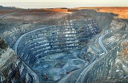 The mega pit at the Sunrise Dam Gold Mine, 55 km south of Laverton, Western Australia. (Owned by AngloGold Ashanti).<br /> <br /> Sunrise Dam's gold deposit was discovered in August 1988 and gold mining operations started in 1995. The mine's first gold pour was in March 1997. Underground operations began in 2003.<br /> <br /> Coordinates 29&deg;08&prime;S 122&deg;42&prime;E