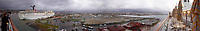 "Panorama of the Ensenada harbor in Mexico on a grey and raining day from the deck of the MV World Odyssey. The other cruse ship is the Carnival Imagination. Once all of the students, faculty, staff, and life long learners were aboard we would be ready to begin the 102 day ""round the world"" Semester at Sea Spring 2016 Voyage. Composite of nine images taken with a Leica T camera and 23 mm f/2 lens (ISO 250, 23 mm, f/2, 1/80 sec). Panorama stitched using AutoPano Giga Pro."