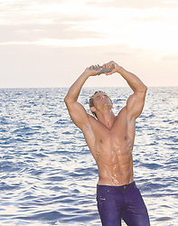 hot guy cooling off in the ocean