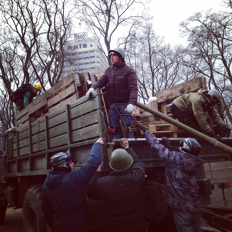 Anti-government protesters load a truck with wood pallets left behind by police, Feb. 22, 2014. #euromaidan #kyiv #ukraine #київ #україна #евромайдан #primecollective