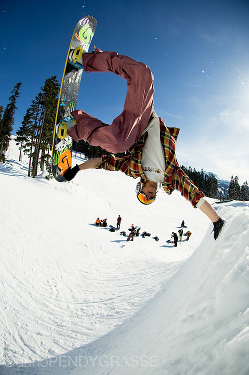 Pro Snowboarder Mark Sollors gets inverted in the Blackcomb terrain park.