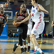 Springfield Armor Guard Larry Anderson (2) dribbles the ball towards the lane as Delaware 87ers Center Ben Strong (44) defends in the course of a NBA D-league regular season basketball game between the Delaware 87ers (76ers) and the Springfield Armor (Nets) Saturday, Dec. 28, 2013 at The Bob Carpenter Sports Convocation Center, Newark, DE.