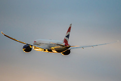 A British Airways Boeing 787 heads for the setting sun in the west as it departs from  London's Heathrow Airport (LHR / EGLL).
