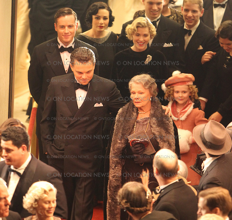"February 10th 2011  Los Angeles, CA. Non-Exclusive. Leonardo DiCaprio as J Edgar Hoover leaving the recreated 1935 movie premiere of ""G- Men"". DiCaprio as FBI Director J. Edgar Hoover walks down the red carpet with his Mother played by Judi Dench and is followed by his Associate Director of the FBI and rumored lover, Clyde Tolson played by actor, Armie Hammer. A young actress portraying Shirley Temple was also in the film premiere scene. Shirley Temple and J Edgar Hoover became good friends in real life. After filming was finished for the night, Director Clint Eastwood posed for a few photos with the adorable Shirley Temple actress. She then waved goodbye to the director, actors and crew before leaving. The premiere scene was filmed at the historic Orpheum Theater on Broadway in Downtown LA. Photo by Eric Ford/ On Location News 818-613-3955 info@onlocationnews.com"