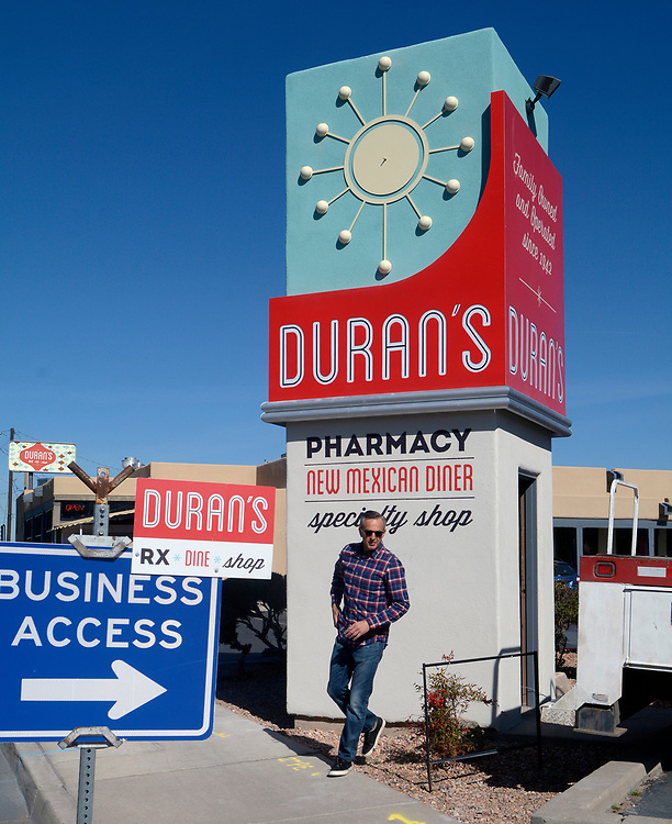 gbs031317b/ASEC -- Len Romano, owner of <br /> Ripe Inc. Branding, Design &amp; Marketing Communications, checks on the progress of the new Duran Central Pharmacy clock tower and sign on Monday, March 13, 2017. Romano said it was inspired by classic mid-century Route 66 designs.(Greg Sorber/Albuquerque Journal)