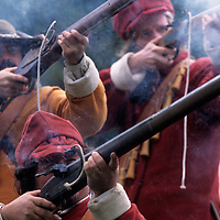 USA, Maryland, (MR) Soldiers in period costume fire muskets at 17th Century battle reenactment at Saint Mary's City