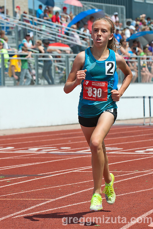 Lake Hazel Middle School seventh grader Lexy Halladay has a substantial lead going into the final lap of  the YMCA Invitational Middle School Championship 7th-8th grade 1600 meter run. Mountain View High School, Meridian, Idaho, May 23, 2015.<br /> <br /> Halladay won the race in 4:53.96, the all-time fastest 1600 meter time run by an Idaho prep girl.
