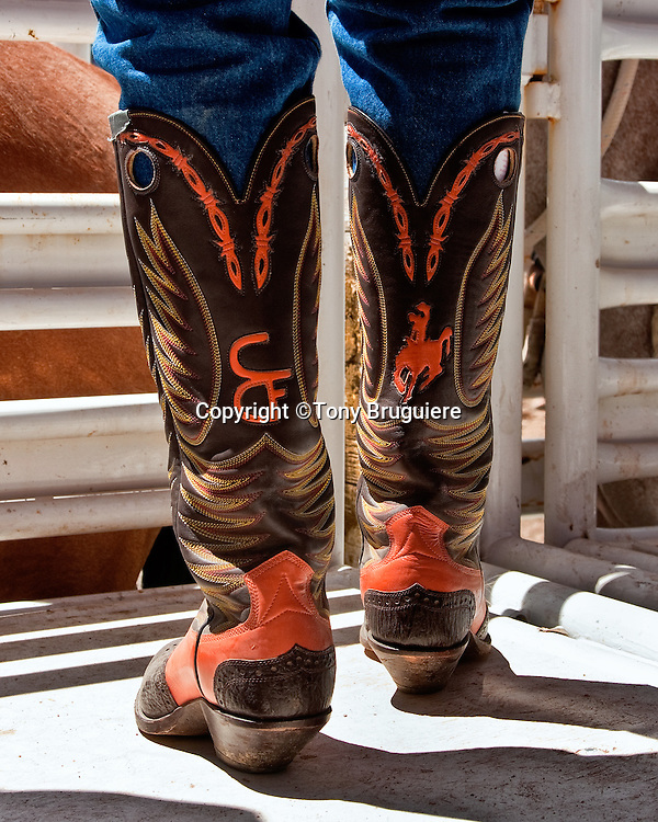 """The boots, spurs, and chaps are functional pieces of equipment used every day by the American cowboy. As well as being functional they can be quite decorative and the spurs are often inlayed with silver or gold.  A pair of decorative boots belonging to Pete """"Stovepipe"""" Pette celebrating his long association with Cheyenne Frontier Days."""
