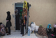 Libya, Garabulli: At Alguaiha detention center Somali migrant women captured at the sea as they were attempting to reach Italy are seen in the courtyard of the facility on May 12, 2015. Alessio Romenzi