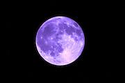 Full, September Blue Moon photographed through a blue lens.