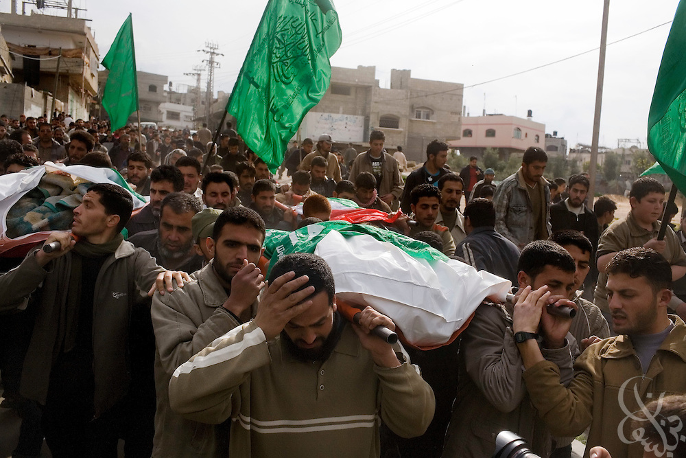 Palestinians carry the bodies of four HAMAS men killed during the recently ended military operation by the Israelis against HAMAS at a January 19, 2009 funeral in the Jabaliya Camp in the Gaza Strip. During the 21 day operation , Israel specifically targeted members of the HAMAS forces and  heavily damaged the groups infrastructure.