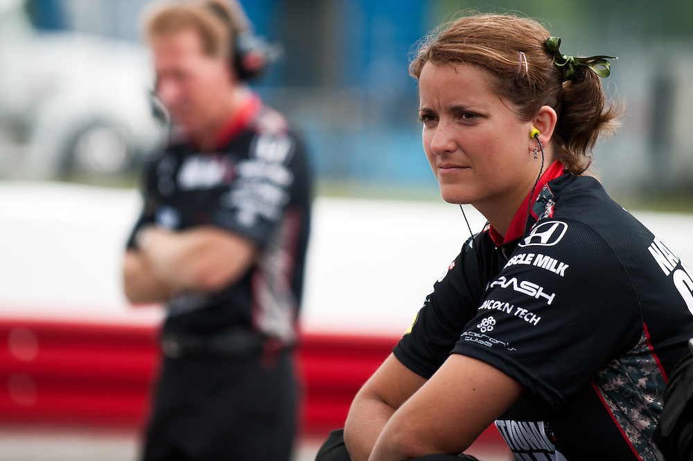 7 August, 2011; Lexington, OH, USA; Unnamed female Panther Racing crew  member sits on pit wall before Sunday mornings practice session; Honda Indy 200, IZOD Indycar Series RD13;  Mandatory Credit: Scott LePage-MotorRacingPhoto    © 2011 Scott LePage  http://MotorRacingPhoto.com