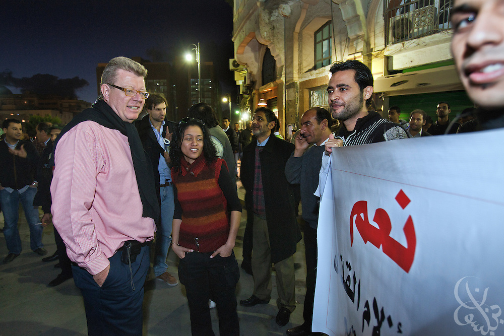 Dr. Ronald Meinardus (l), Regional Director of the Friedrich Naumann Foundation for Liberty (FNF) listens as Libyan activist and journalist Nadar Ebkoora (c) translates a protest sign at a continue the revolution rally in Benghazi, Libya December 16, 2011. More than 6 months after the revolution began in Libya, efforts at building new democratic institutions are still in the early stages, and Libyans activists are increasingly demanding increased transparency during this process. (Photo by Scott Nelson, for Der Spiegel)