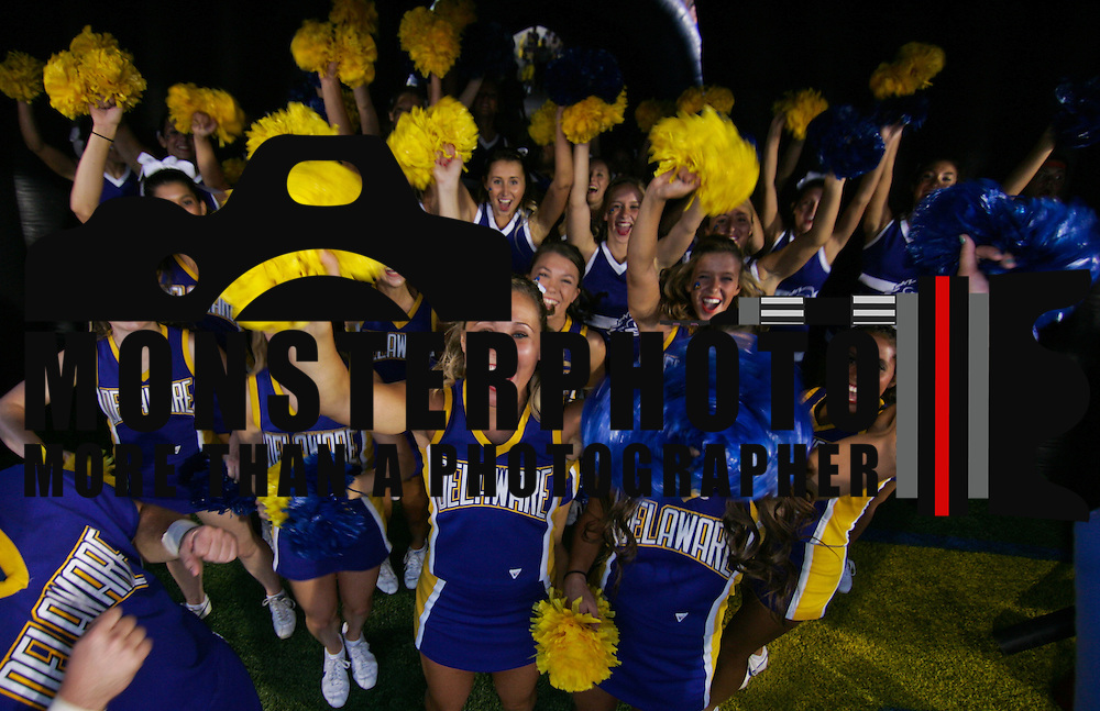 University of Delaware Cheerleaders having fun prior to a Week 1 NCAA football game against West Chester. ..#8 Delaware defeated West Chester 41-21 in their home opener at Delaware Stadium Thursday Aug. 30, 2012 in Newark Delaware...Delaware will return home Sept. 8, 2012 at 3:30pm for a showdown with interstate Rival Delaware State in the Route 1 Rivalry Bowl at Delaware Stadium.