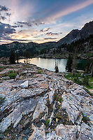 A Summer sunrise over the rocks near Cecret Lake in Utah's Wasatch Mountains.