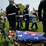 "An honor guard carries the casket of  Marine Sgt. Jon ""J.J."" Bonnell Jr. at his burial service at Memorial Park Cemetery in Ft. Dodge, Iowa.  Bonnell was killed in Iraq in 2007."
