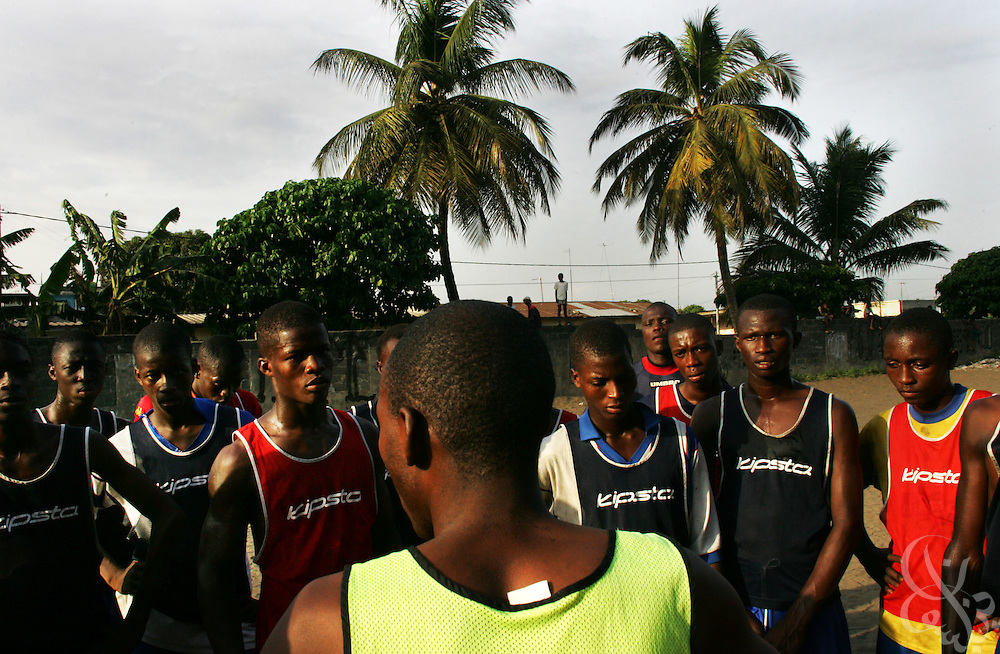 "The"" Almighties of Koomassi"" academy football club practices in the Koomassi neighborhood of Abidjan, Ivory Coast February 17, 2006.  Trying to mimic the successes of ASEC academy, more than 300 rival football academies have been started in Abidjan. Parents hoping of their children will become national team members or pro european league players often become indebted in order to put their children into the copycat academies, which focus on football skills, but do little to educate the young Ivorians who attend them.   ."