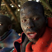 IPMG0368 South Africa, Flagstaff, 1998: Xhosa initiates inside their lodge made of branches during their seclusion, having undergone the circumscision rite of passage to manhood in tribal Xhosa culture in the former Transkei homeland, near Flagstaff,  July 1998...Photograph by Greg Marinovich/South Photographs