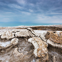 Israel, Wind-carved salt formations along eroded shoreline of Dead Sea south of Ein Gedi