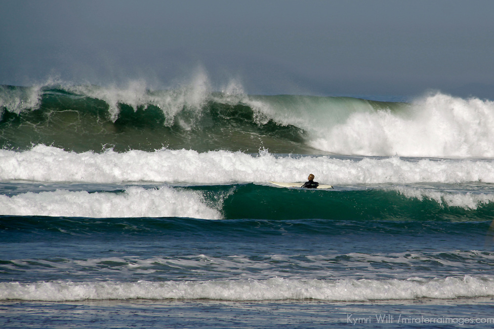 USA, California, San Diego. Surfer faces wall of water at La Jolla Shores during winter swell.