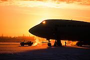 Alaska. Fairbanks International Airport. A comercial jet airplane at sunset.