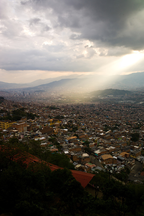 Rays of sunlight over Medellín, Colombia, seen from the Biblioteca España (Spain Library).