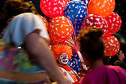 """Jahirt Bermudez, of Colombia, South America, who performs as Perolito the clown for the Cole Bros. Circus, sells ballons during intermission at a stop in Frederick Maryland. The Cole Bros. Circus of the Stars is celebrating its 127th season and bills itself as the """"World's Largest Circus Under The Big Top."""""""
