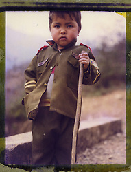 Polaroid 79's portrait of a young child wearing military clothes.