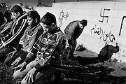 Jimaan, Badr and Ala&agrave; sometimes skip going to the mosque and instead hold their Friday prayers at the front line.<br /> Nov. 2002 The boys from Ramallah.
