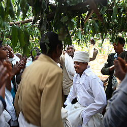 Priest Nigatu Alebachew dances with guests after peforming the marriage of Tsegaya Mekonen, 13, and Talema Meseret, 23, in Yeganda Village, Amhara Region, Ethiopia on May 20, 2007. The practice of early marriage remains widespread in Ethiopia, especially in the northern Amhara and Tigray regions, where parents consent to their daughters? consummated marriages when they are still as young as 10 or 12. In Amhara, 50 percent of girls are married by the age of 15, despite the enactment in 2000 of the revised Family Law, which sets the legal age for marriage at 18.