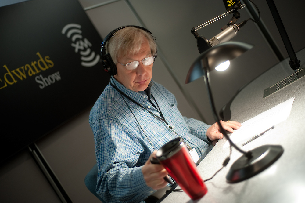 Bob Edwards, preparing to conduct an interview in his studio.