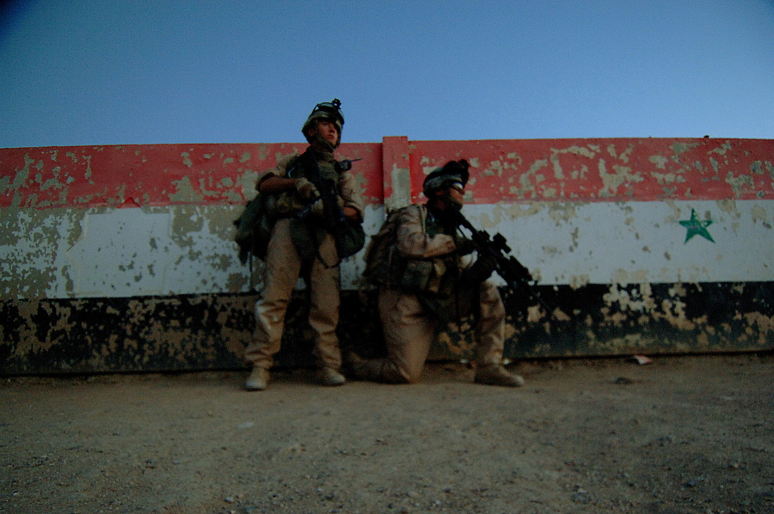 Soldiers from 40th Engineers, 1st Armored Division, 2nd Brigade Combat Team, Baumholder, Germany, prepare to conduct an early morning raid, looking for weapon caches, on a local school and several houses in the Tameem district of Ramadi, Iraq on September 03, 2006 during Operation Caribbean Stud. No significant evidence was found. — © TSgt Jeremy Lock/