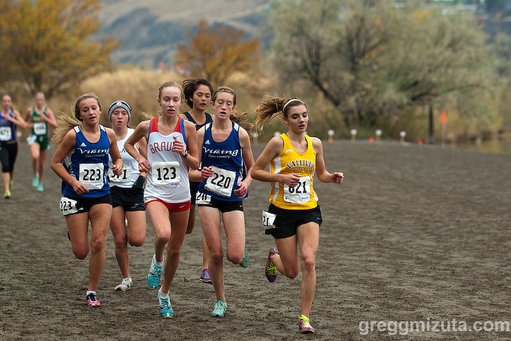 The lead pack (L to R: Punky Duran Presli Hutchison, Emily Hamlin, Lila Klopfenstein, Josie Brown, and Mikayla Malaspina) at the start of the second loop during the  Idaho High School Cross Country State 5A Championships on October 27, 2012 at Hells Gate State Park in Lewiston, Idaho.<br />