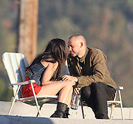 "July 23rd 2010  Los Angeles, CA.  ***EXCLUSIVE*** Megan Fox and Dominic Monaghan share some Vodka and a passionate kiss while sitting on lawn chairs on the rooftop of a Liquor store in a gritty  Los Angeles neighborhood. Fox and Monaghan spent the day filming scenes together for their starring roles in Eminem and Rihanna's music video for ""The Way You Lie"". An injury of some kind is visible on Megan's elbow which is probably fake and for her character. Megan and Dominic also filmed a scene inside the liquor store as well as inside a seedy dive bar next door. Photo by Eric Ford/ On Location News 818-613-3955"