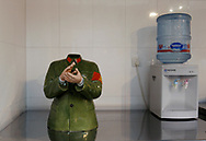 A modern take on Mao's red guards crafted in porcelain sits next to a water cooler at a cafe in Beijng's art district, China, Tuesday, Dec.16, 2008. Before the economic reforms, art in communist China was limited mostly to propaganda. Now propaganda items are sold as Communist kitsch and the scene is vibrant following a revival thanks to the 1978 reforms allowing for more personal freedoms. Now Chinese artists are feted by the international art scene, and their work sells in the million of dollars.<br />