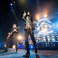 Charlie Burchill and Jim Kerr of Simple Minds performs live at The SEE Hydro on November 28, 2015 in Glasgow,Scotland
