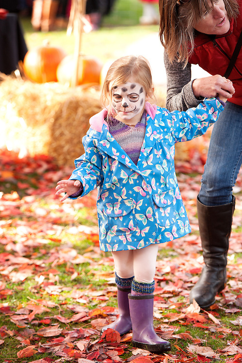 Two year old Casey Balano, with her face painted as Marshall the Dalmation from Paw Patrol, at the Pumpkin Patch at Stan Clarke Park.