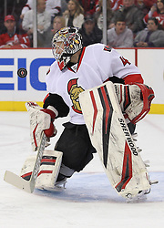 Apr 7; Newark, NJ, USA; Ottawa Senators goalie Craig Anderson (41) makes a save during the first period of their game against the New Jersey Devils] at the Prudential Center.