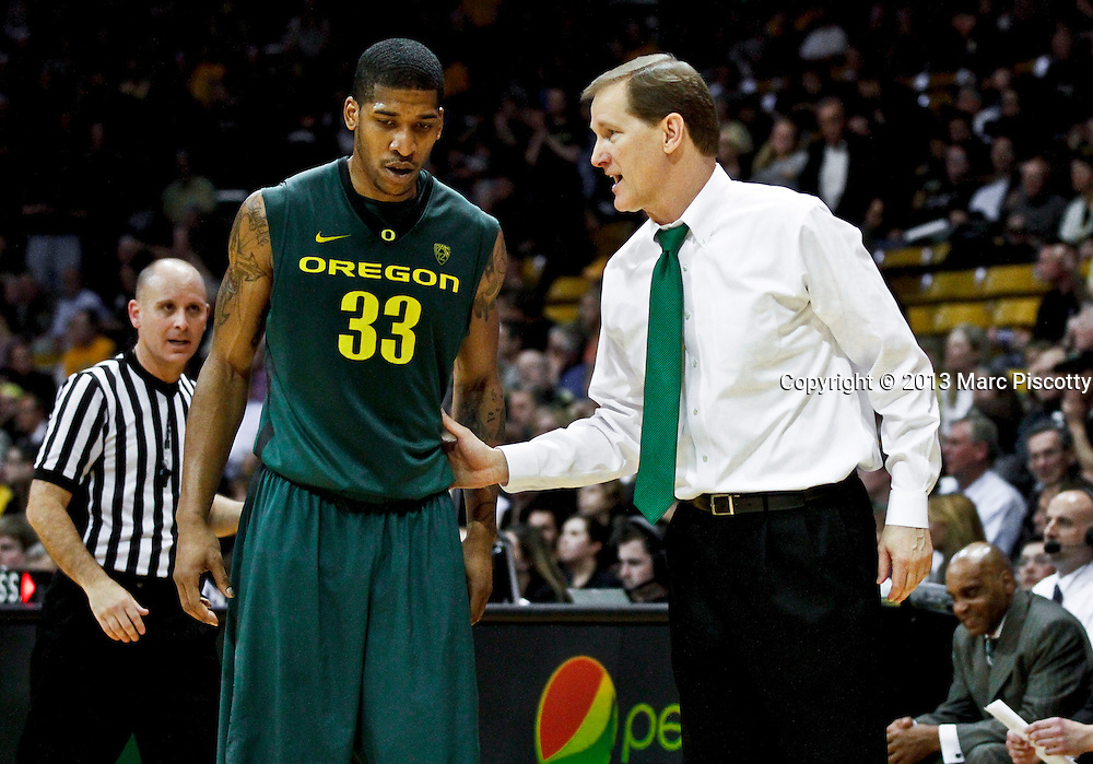 SHOT 3/7/13 9:58:56 PM - Oregon head basketball coach Dana Altman coaches his player Carlos Emory #33 as his team plays against Colorado during their Pac-12 Conference regular season basketball game at the Coors Events Center on the University of Colorado campus in Boulder, Co. Colorado won the game 76-53..(Photo by Marc Piscotty / © 2013)