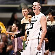 SHOT 1/21/12 6:41:33 PM - Colorado's Shane Harris-Tunks #15 reacts from the bench after a teammate scores against Arizona during their PAC 12 regular season men's basketball game at the Coors Events Center in Boulder, Co. Colorado won the game 64-63..(Photo by Marc Piscotty / © 2012)