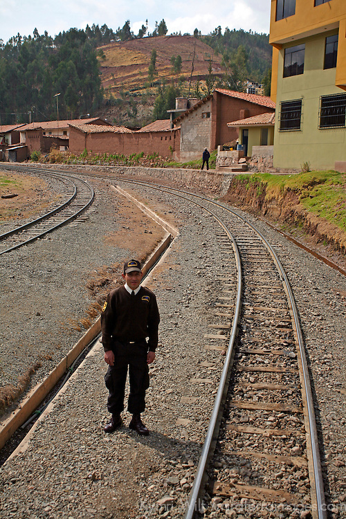 South America, Peru. Guard minding the track from Piroy Station for trains heading to Machu Picchu.