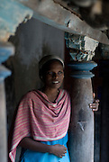 Woman beside courtyard of old home. Goldsmith Street, Tranquebar.<br /> Tamil Nadu. South India.