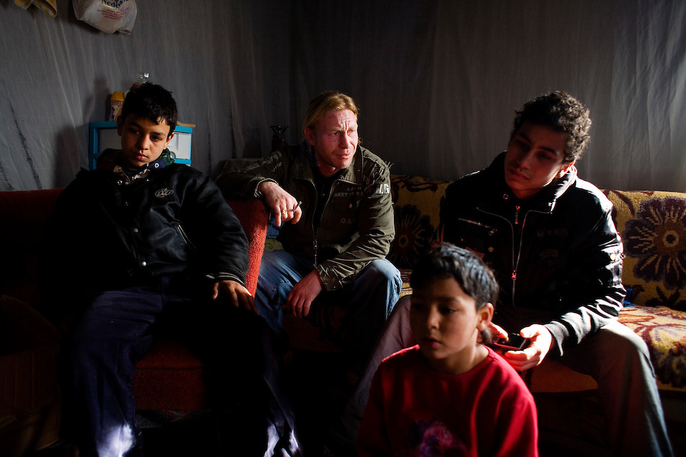 A family displaced from the Gazela settlement sits in their new home in the Belville camp. They had first returned to their village in southern Serbia but decided to return to Belgrade in search of work.