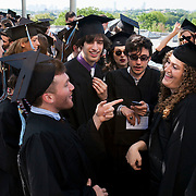 05/19/2013 - Medford/Somerville, Mass. - Students line up at Alex's Place on the roof of Tisch Library at Tufts University's 157th Commencement  on May 19, 2013. (Kelvin Ma/Tufts University)