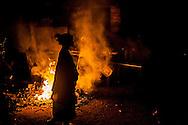 Bajau women burn garbage in front of their homes
