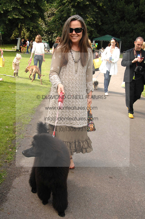 KOO STARK and Dolly the dog at Macmillan Dog Day in aid of Macmillan Cancer Support, held at Royal Hospital Chelsea, London on 3rd July 2007.<br />