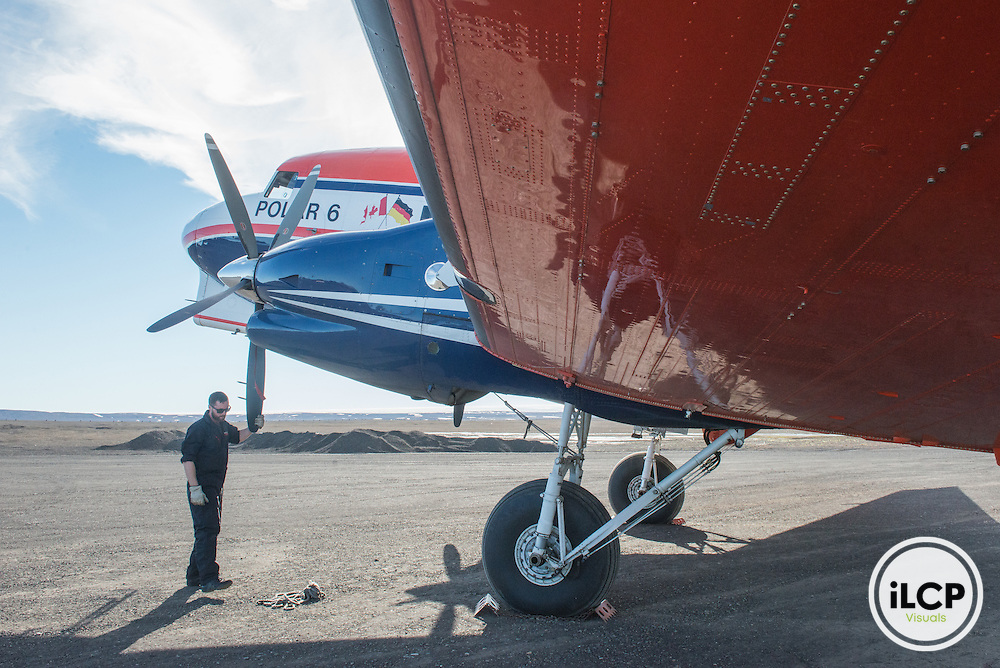 Jorgen Christison, first officer on Polar 6 checks the propellers after a flight for daily maintenance. Station Nord, Greenland, DK, July 23, 2016, Esther Horvath / iLCP