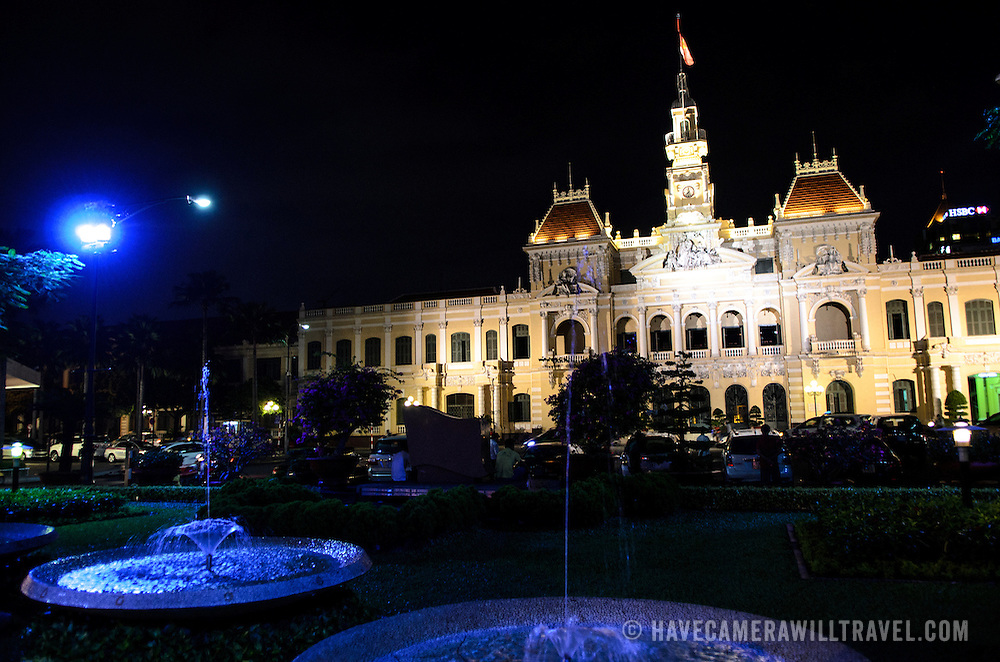 Blue fountains in front of Ho Chi Minh City Hall in downtown Saigon. Ho Chi Minh City Hall was built in the early 20th Century by the French colonial government as Saigon's city hall. It's also known as Ho Chi Minh City People's Committee Head office, in French as Hôtel de Ville de Saigon, and in Vietnamese as Tr? s? ?y ban Nhân dân Thành ph? H? Chí Minh.