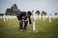 Brithis veteran Mr. Victor A. Walker 87 pay tribute to an american  soldier called Walker  in the American cemetery in Ohama beach